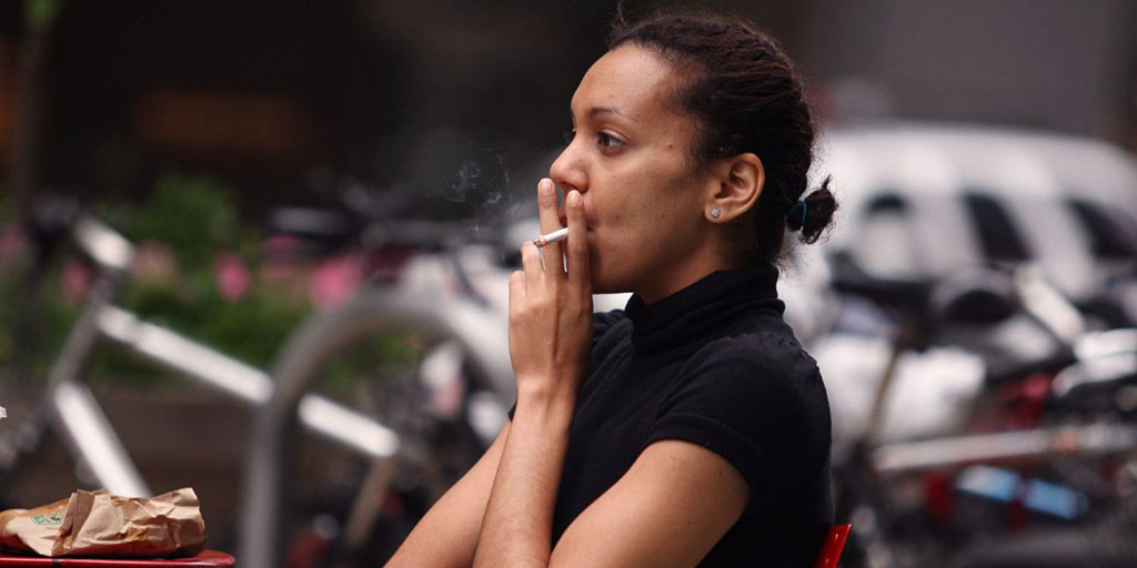African American Woman Lights Up a Cigarette