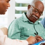 Elderly Couple Consulting Social Worker